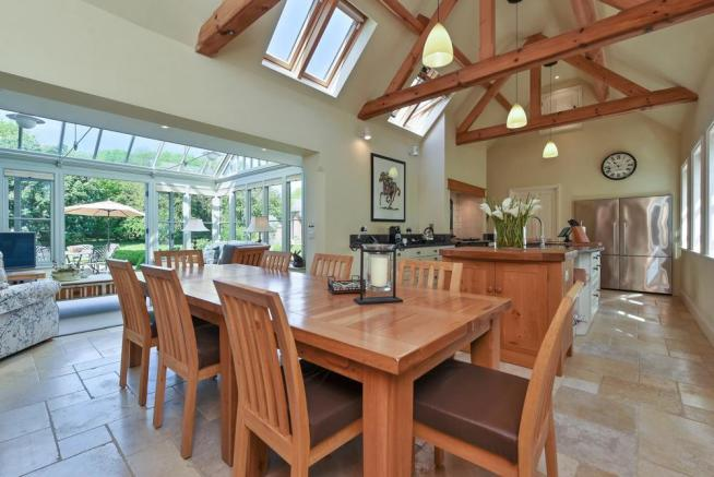 Open plan kitchen/diner leading to conservatory