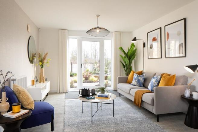 Inside view of lounge area with French doors opening onto open space. Coleford, 2 bed apartment.