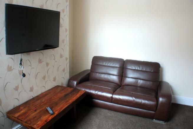 living room + sofa gold property