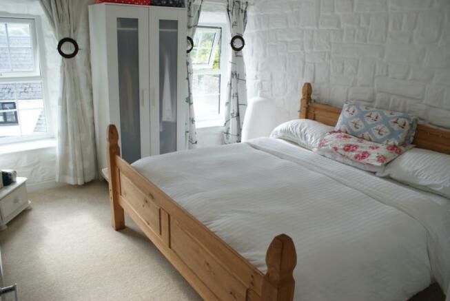 Master bedroom (furnishings not provided)
