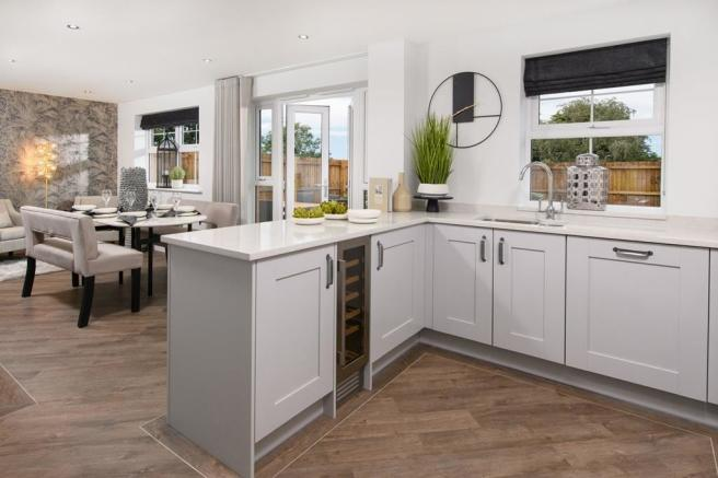 The Radleigh - Open-plan kitchen/dining area with French doors onto garden
