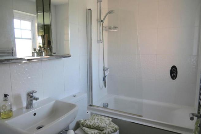 REDESIGNED AND UPGRADED EN-SUITE BATHROOM