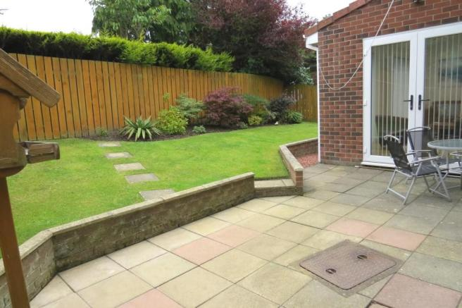 METICULOUSLY MAINTAINED GARDENS
