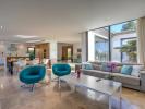 Luminosa sala de estar de una villa moderna en Bonaire, Alcudia