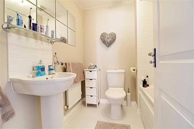 PART TILED FAMILY BATHROOM/WC