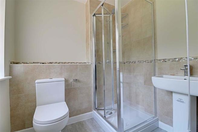 RECENTLY RE-FITTED PART TILED SHOWER ROOM/WC