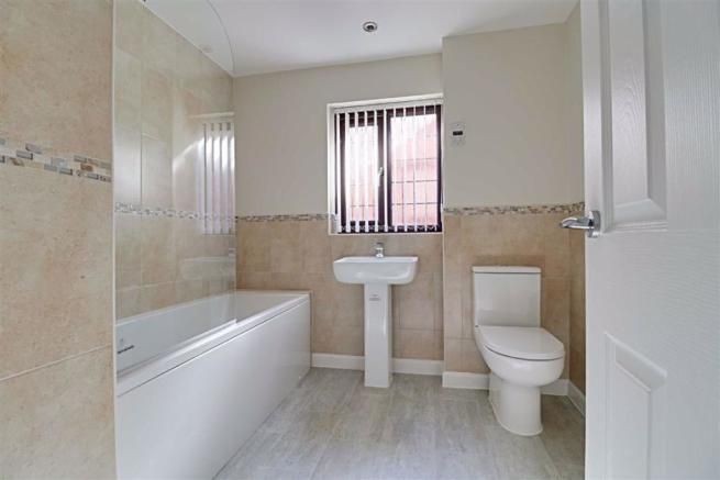 RECENTLY RE-FITTED PART TILED FAMILY BATHROOM/WC