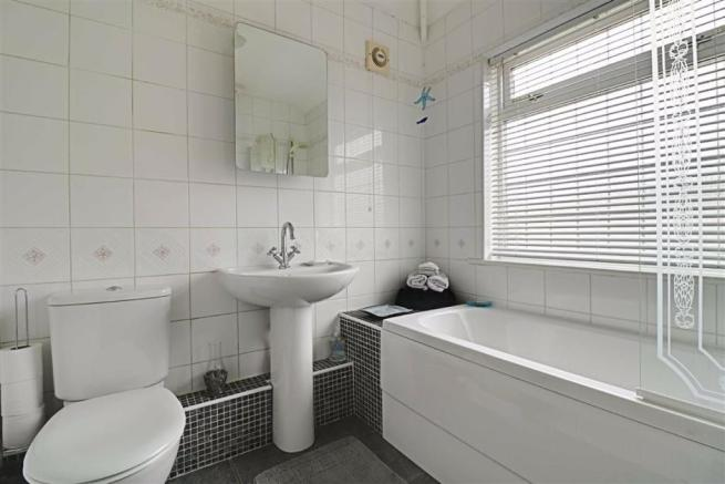 RE-FITTED FULLY TILED BATHROOM/WC