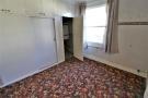 Bedroom Three With Window To Rear & Cupboard Housi