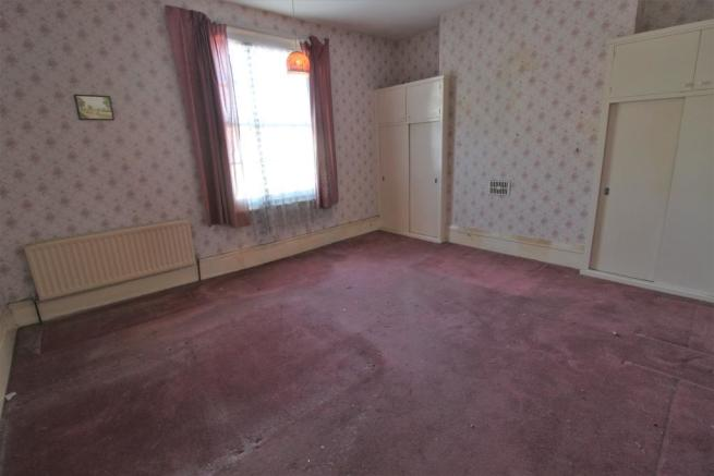 Bedroom One With Window To Rear