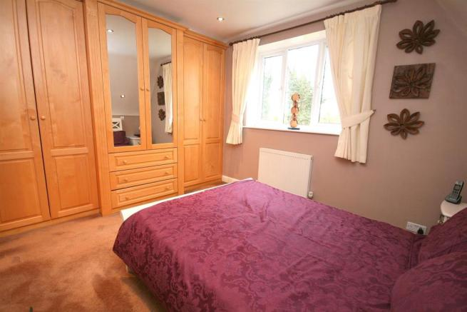 Bed 1 with built in Wardrobes