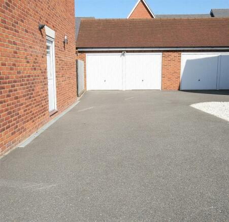 Driveway & Double Garage.