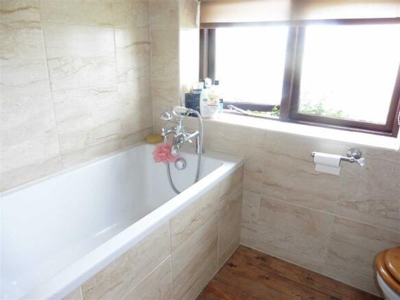 Fully tiled bathroom (side)