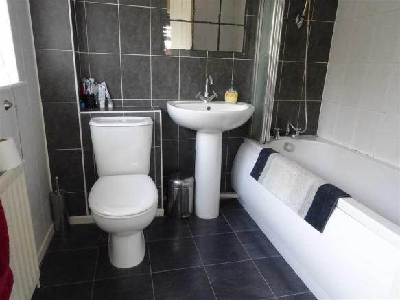 Modern fully tiled bathroom (rear)