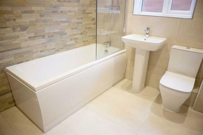 Luxury fully tiled bathroom (side)
