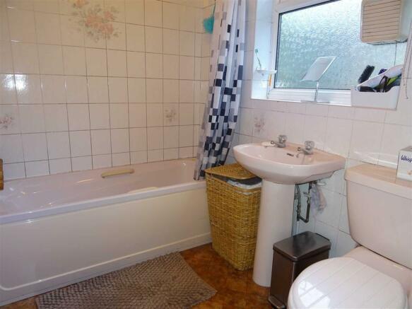 Fully tiled bathroom (rear)