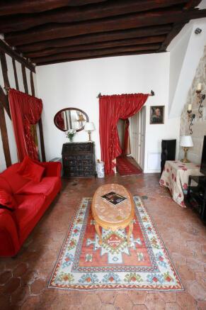 Living room tiled floor wooden beams Rue Frederic Sauton Paris
