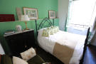 Bedroom wood floor iron bed Rue Frederic Sauton Paris