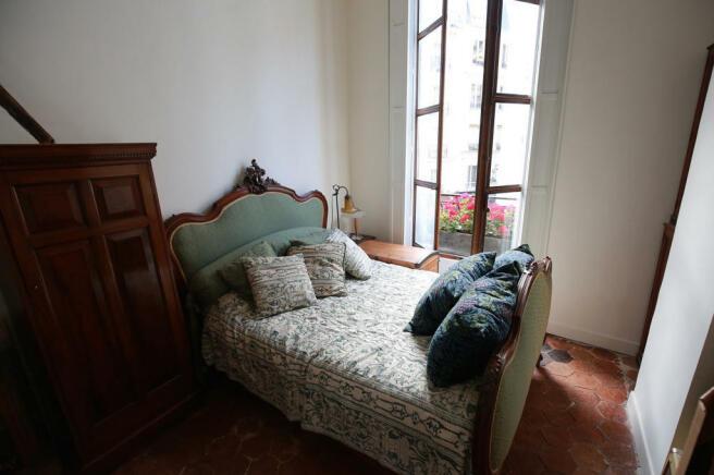 Bedroom tiled floor large window Rue Frederic Sauton Paris