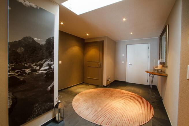 Entrance hallway stone floor Chalet Im Maad Verbier