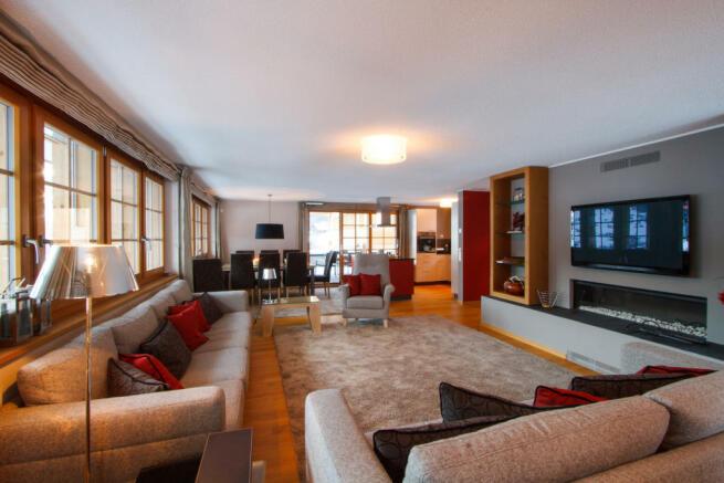 Living room dining kitchen open plan wood floor Chalet Im Maad Verbier