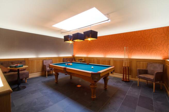 Games room pool table tiled floor Chalet Im Maad Verbier