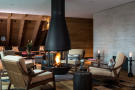 Living room dining fireplace open plan area Andermatt Chedi Residences