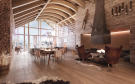 Open plan dining living room fireplace Andermatt Chedi Residences