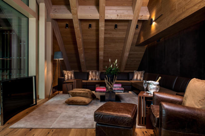 Living room cinema home wood floor Andermatt Chedi Residences