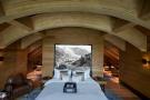 Master bedroom curved ceiling wood floor Andermatt Chedi Residences