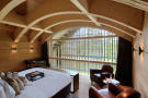 Bedroom master wood floor curved ceiling Andermatt Chedi Residences