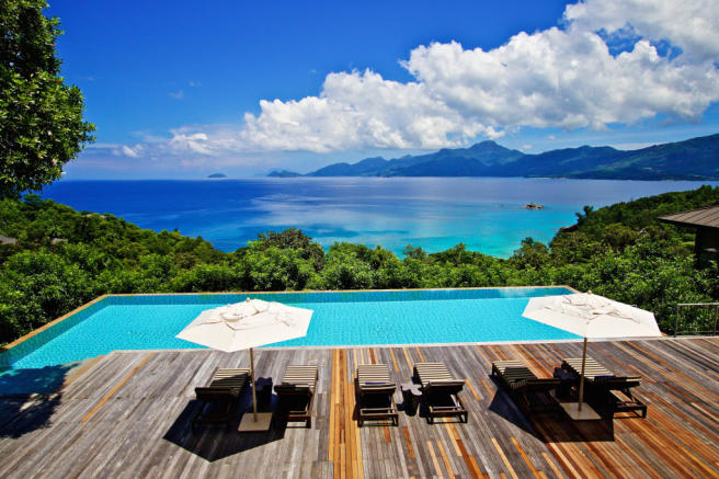 Swimming pool sun terrace ocean sea view Four Seasons Seychelles