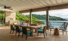 Outdoor dining area covered terrace Four Seasons Seychelles