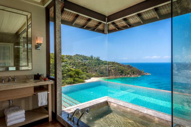 Bathroom bath tub sea view ocean swimming pool Four Seasons Seychelles