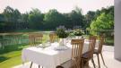 Outdoor dining area terrace La Selva Apartments PGA Catalunya Girona