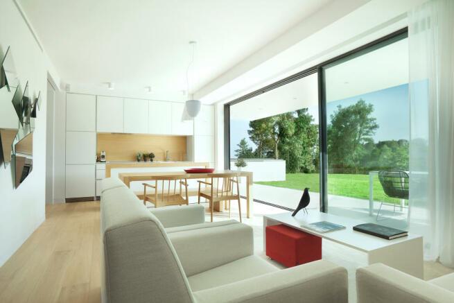 Living room kitchen sliding doors wood floor La Selva Apartments PGA Catalunya Girona