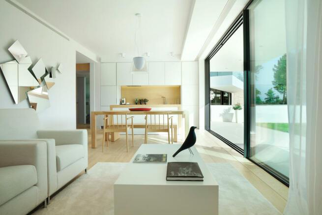 Living room kitchen open plan breakfast bar sliding doors La Selva Apartments PGA Catalunya Girona