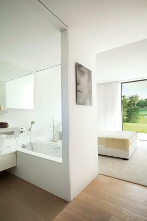 Bedroom ensuite bathroom bath tub wood floor La Selva Apartments PGA Catalunya Girona