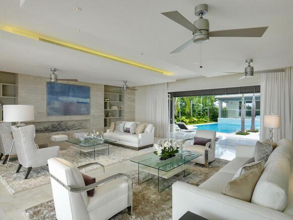 Living room sliding doors stone floor Villa Bonita Barbados