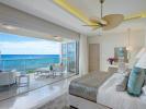 Bedroom stone floor sliding doors balcony Villa Bonita Barbados