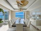 Dining room sliding doors stone floor ocean sea view Villa Bonita Barbados