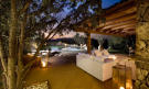 Covered area night tiled swimming pool Villa Ross Sardinia