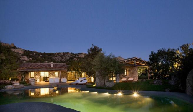 Rear facade swimming pool night terrace Villa Ross Sardinia