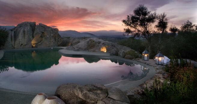 Swimming pool night view Villa Ross Sardinia