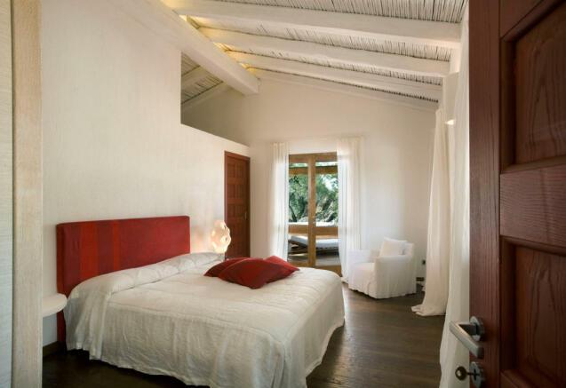 Bedroom wood floor french doors Villa Ross Sardinia