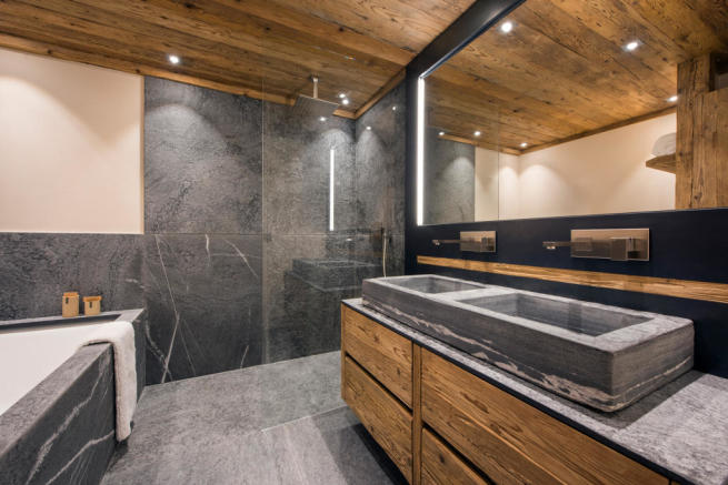 Bathroom twin sink shower bath tub stone Residence Alex Verbier