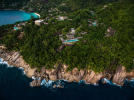 Aerial view of Kokomo in the Seychelles and Petite Anse bay beyond