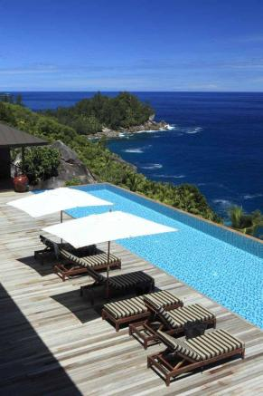 Swimming pool sun terrace ocean sea view Kokomo at Four Seasons Seychelles