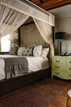 Close up of bed with bedside table