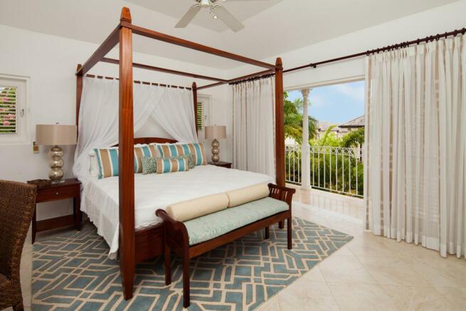 Bedroom stone floor balcony doors master Battaleys Mews St Peter Barbados